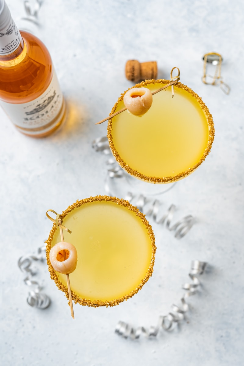 New Year's Golden Tiki Cocktail ( Gold Rum Lychee Champagne Cocktail) with koloa bottle www.pineappleandcoconut.com