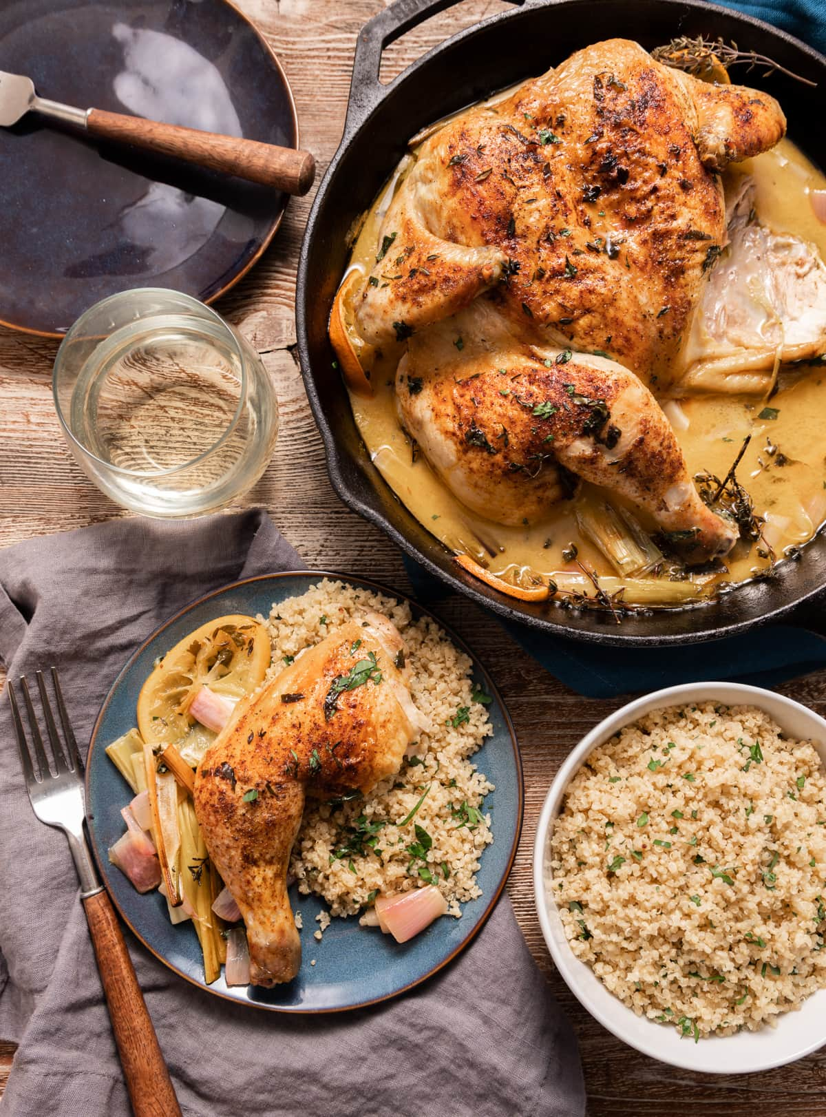 spatcocked roasted chicken in a skillet, plate of chicken with quinoa