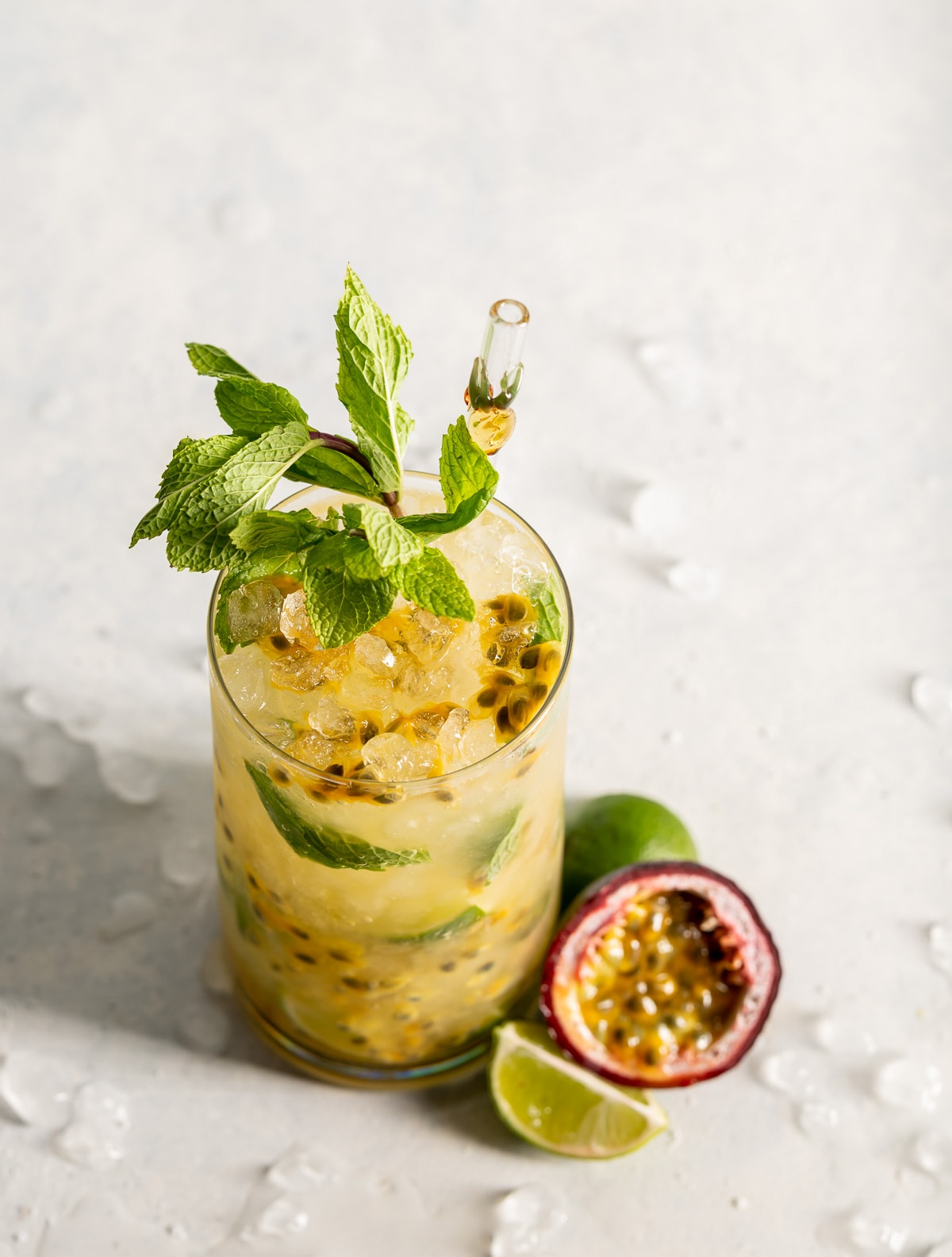 cocktail with passion fruit and mint slices of lime